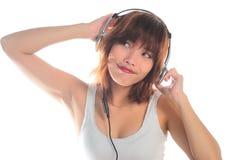 Нот молодой азиатской женщины слушая Стоковые Изображения RF