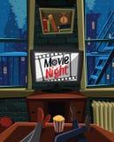 Ночь кино на ТВ в теплой квартире Стоковые Изображения