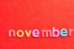 Ноябрь на красной предпосылке Стоковые Фотографии RF