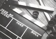 Нумератор с хлопушкой кино на деревянной предпосылке Стоковые Изображения RF