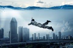 Нырять в бизнесмене воды Мультимедиа стоковая фотография rf