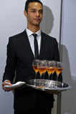 НЬЮ-ЙОРК, NY - 13-ОЕ ОКТЯБРЯ: Шампань была послужена на представлении Каролины Herrera Bridal Стоковые Фотографии RF