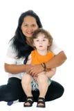 Няня обнимая мальчика стоковая фотография