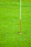 добавьте текст вылазок отверстия гольфа зоны реклам правый к Стоковое фото RF