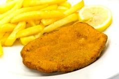 обваленные в сухарях fries франчуза котлеты стоковое изображение
