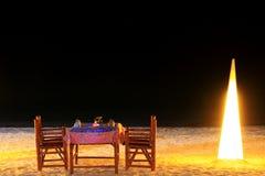 Обедая таблица в вечере Стоковые Изображения RF
