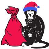 Обезьяна дает подарки на рождестве и Новом Годе Стоковое фото RF