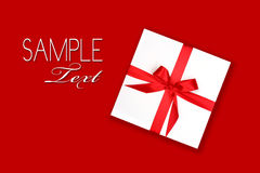 обернутая тесемка праздника подарка совершенно красная Стоковое Фото