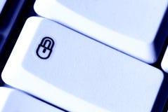 обеспеченность замка компьютера кнопки Стоковое фото RF