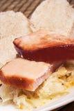 Обед, копченое мясо с sauerkraut и дом сделали вареники Стоковая Фотография RF