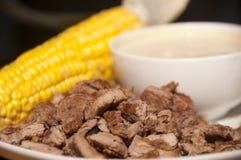 Обед с мозолью и зажаренным в духовке мясом Стоковые Изображения