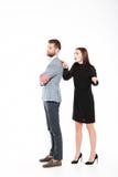 Обиденные молодые любящие пары присягают изолированный Стоковое фото RF