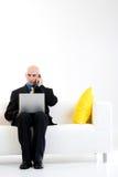 облыселый принимать звонока бизнесмена Стоковое Изображение RF