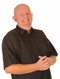 Облыселый смеяться над человека Стоковое фото RF