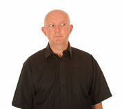 Облыселый человек смотря к стороне Стоковые Фотографии RF