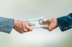 Обменивать великобританский фунт стерлинга денег Стоковые Изображения RF
