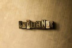 ОБМЕН - конец-вверх grungy слова typeset годом сбора винограда на фоне металла Стоковое Фото