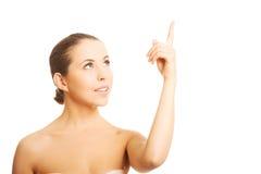Обнажённая женщина указывая вверх Стоковая Фотография