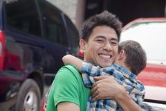 Обнимать отца и сына стоковая фотография rf