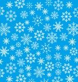 Обои Нового Года голубые, текстура снежинок Стоковые Изображения