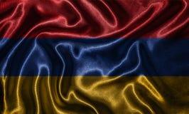 Обои флагом Армении и развевая флагом тканью стоковое изображение