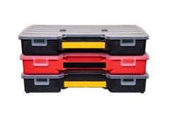 Оборудование мастера 3 профессиональных пластиковых ящика для хранения для изолированных винтов, болтов, шпонок и некоторых други стоковые фотографии rf