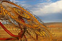 Оборудование сельского хозяйства на заходе солнца Стоковое Изображение