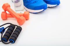 Оборудование фитнеса на белой предпосылке Стоковое Фото