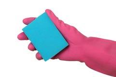 Оборудование чистки, губка в руке стоковое изображение