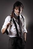 Обольстительный гангстер с корокоствольным оружием стоковая фотография rf
