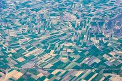 Обрабатыванный землю ландшафт вида с воздуха полей Стоковые Фото