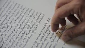 Обручальные кольца на странице книги видеоматериал