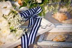 Обручальные кольца, bridal букет, cockleshells, рамки для p Стоковые Фотографии RF