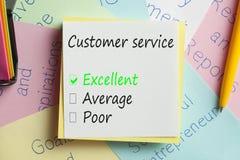 Обслуживание клиента написанное на примечании Стоковая Фотография