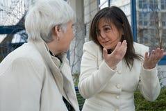 обсуждать женщин Стоковое Фото