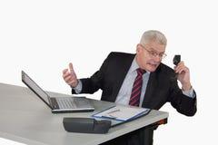 обсуждать старший телефона менеджера Стоковое фото RF