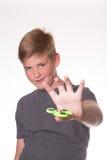Обтекатель втулки непоседы удерживания мальчика Стоковые Фото