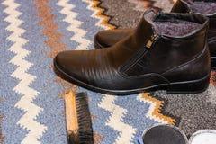 Обувь на половике Стоковые Фото