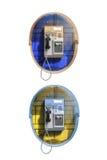 Общественный телефон на белой предпосылке Стоковое фото RF