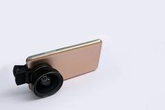 Объектив зажима с мобильными телефонами в белой предпосылке Стоковое Изображение RF