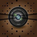 Объектив фотоаппарата и фильм на коричневой предпосылке Стоковая Фотография RF