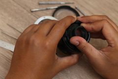 Объектив фотоаппарата починки, 1-й вариант стоковые фото