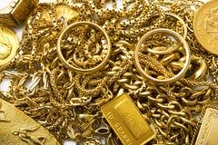 Объекты золота на белой предпосылке Стоковые Изображения RF