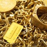 Объекты золота на белой предпосылке Стоковое Изображение RF