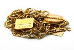 Объекты золота на белой предпосылке Стоковые Фото