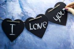 Объявление влюбленности написанное в сердцах Стоковые Фотографии RF