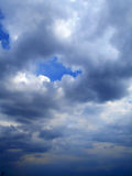 Облака в предпосылке голубого неба Стоковая Фотография