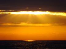 Облака и море Солнця Стоковые Изображения