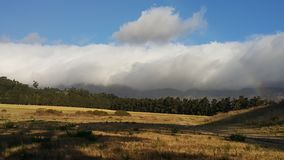 Облака над полем и облаками Стоковые Фотографии RF