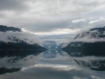 Облака над фьордом Стоковая Фотография